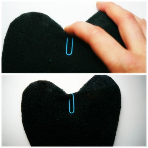 putting cloth pin on sock puppet