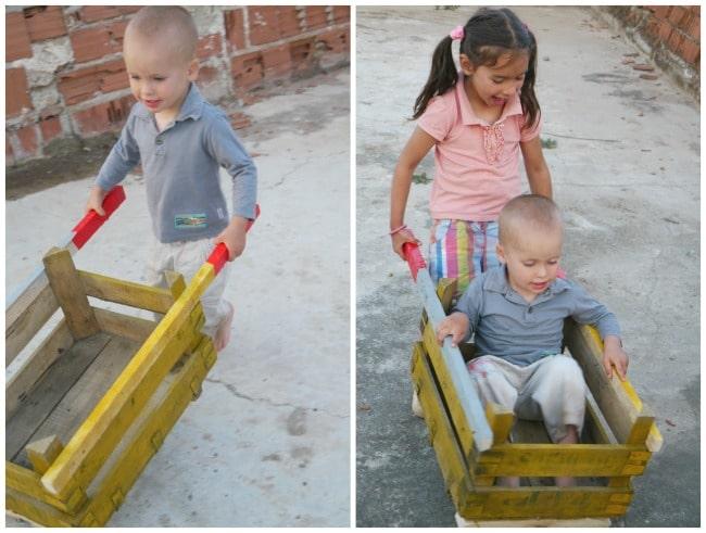 diy wheelbarrow playing with sister