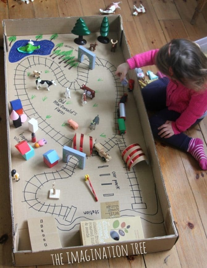playing-with-train-tracks-in-box-680x877