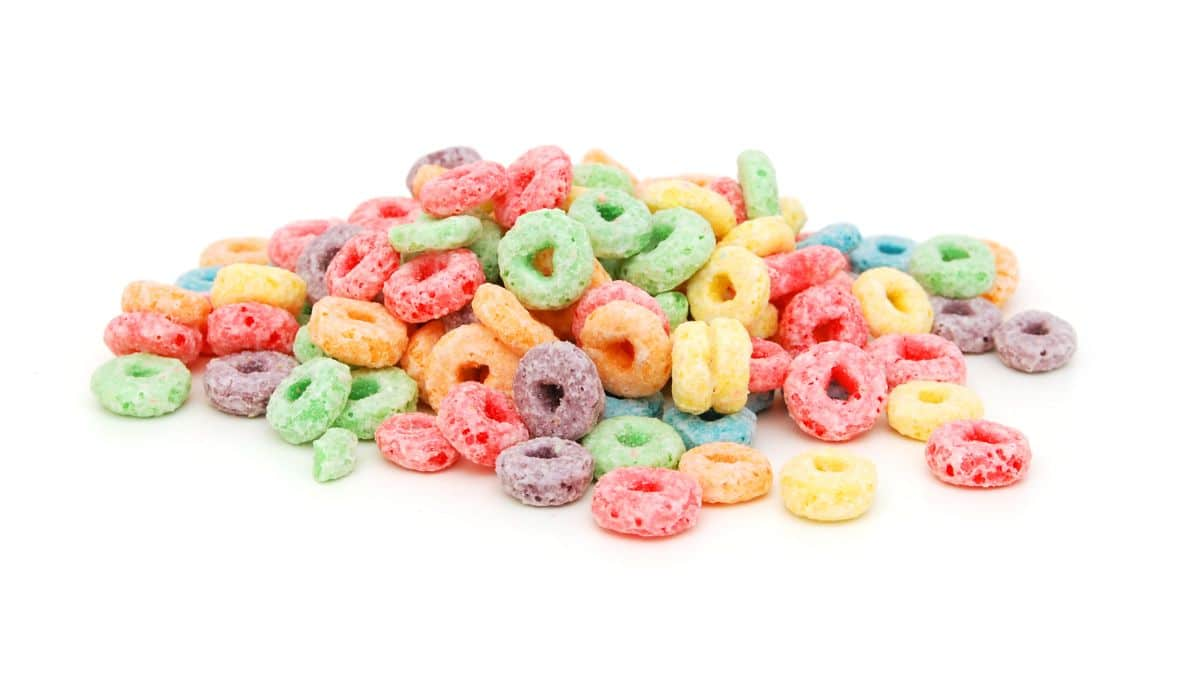 on a white background is a pile of fruit loops