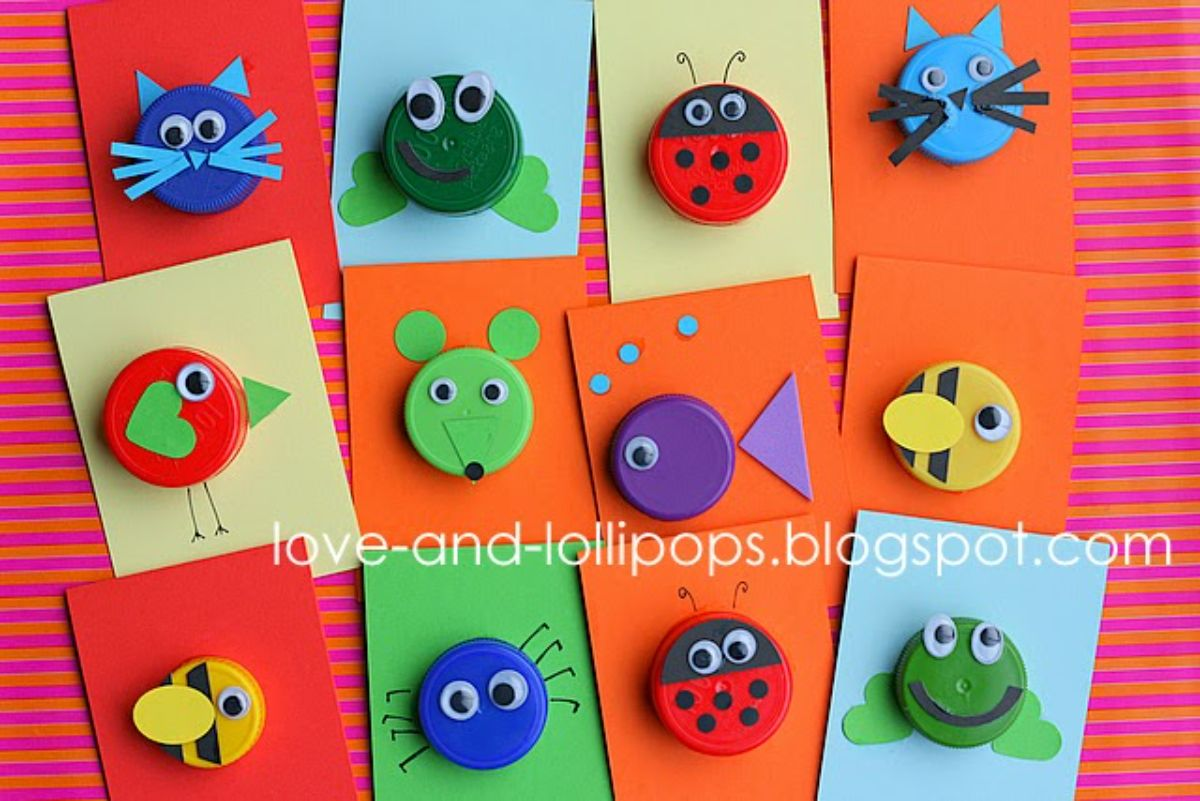 square pieces of colored card can be seen. On each one is a bottle top made to look like a different animal