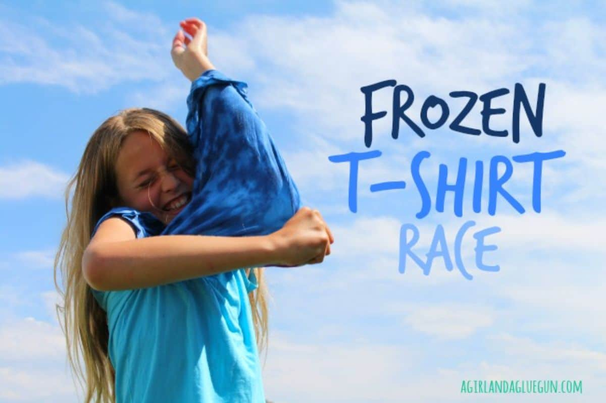 """The text reads """"Frozen T-shirt race"""" the image is of a girl in a blue shirt trying to put on a darker blue shirt"""