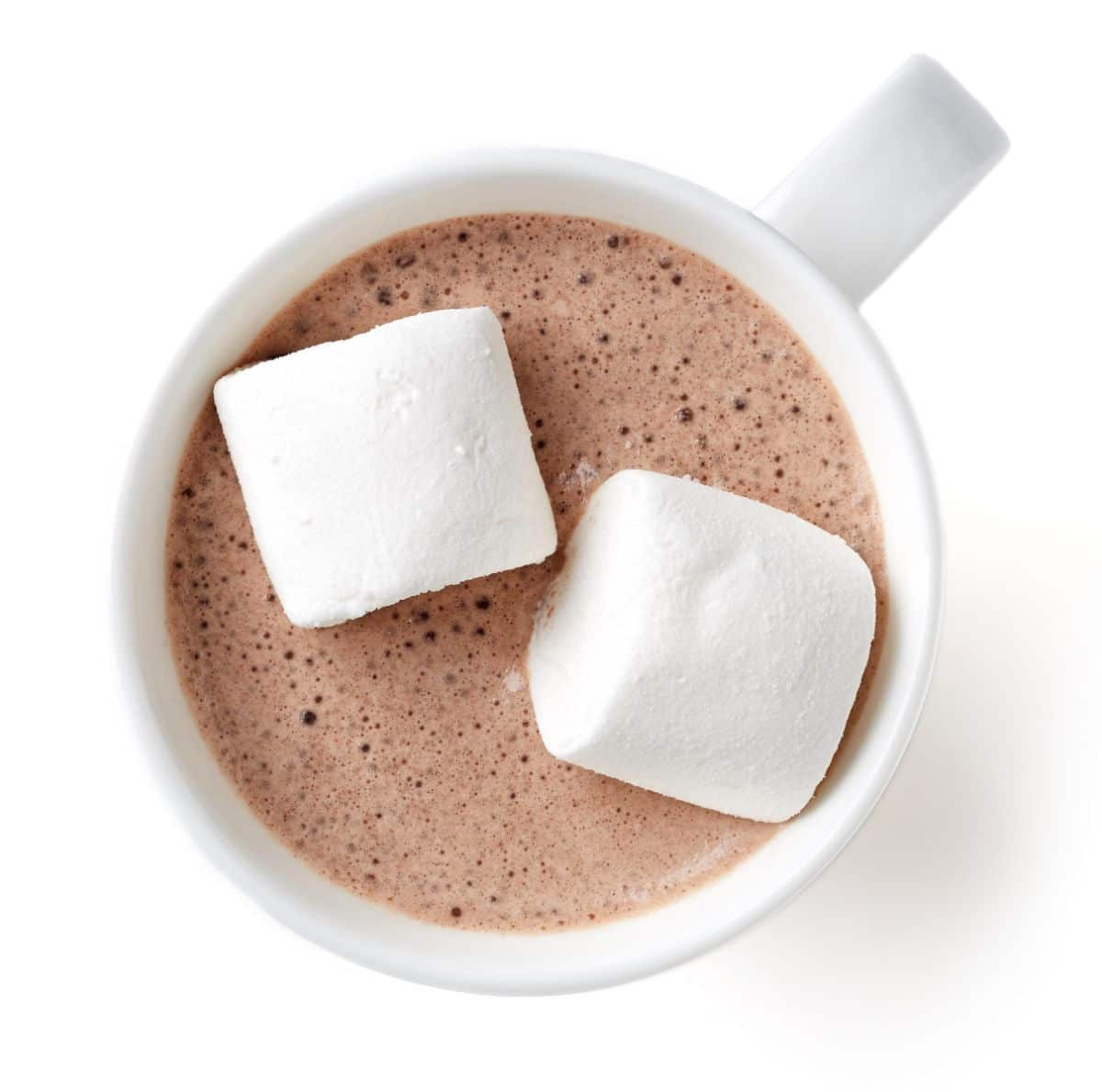 on a white background is an aerial view of a white mug filled with hot chocolate and topped with 2 marshmallows
