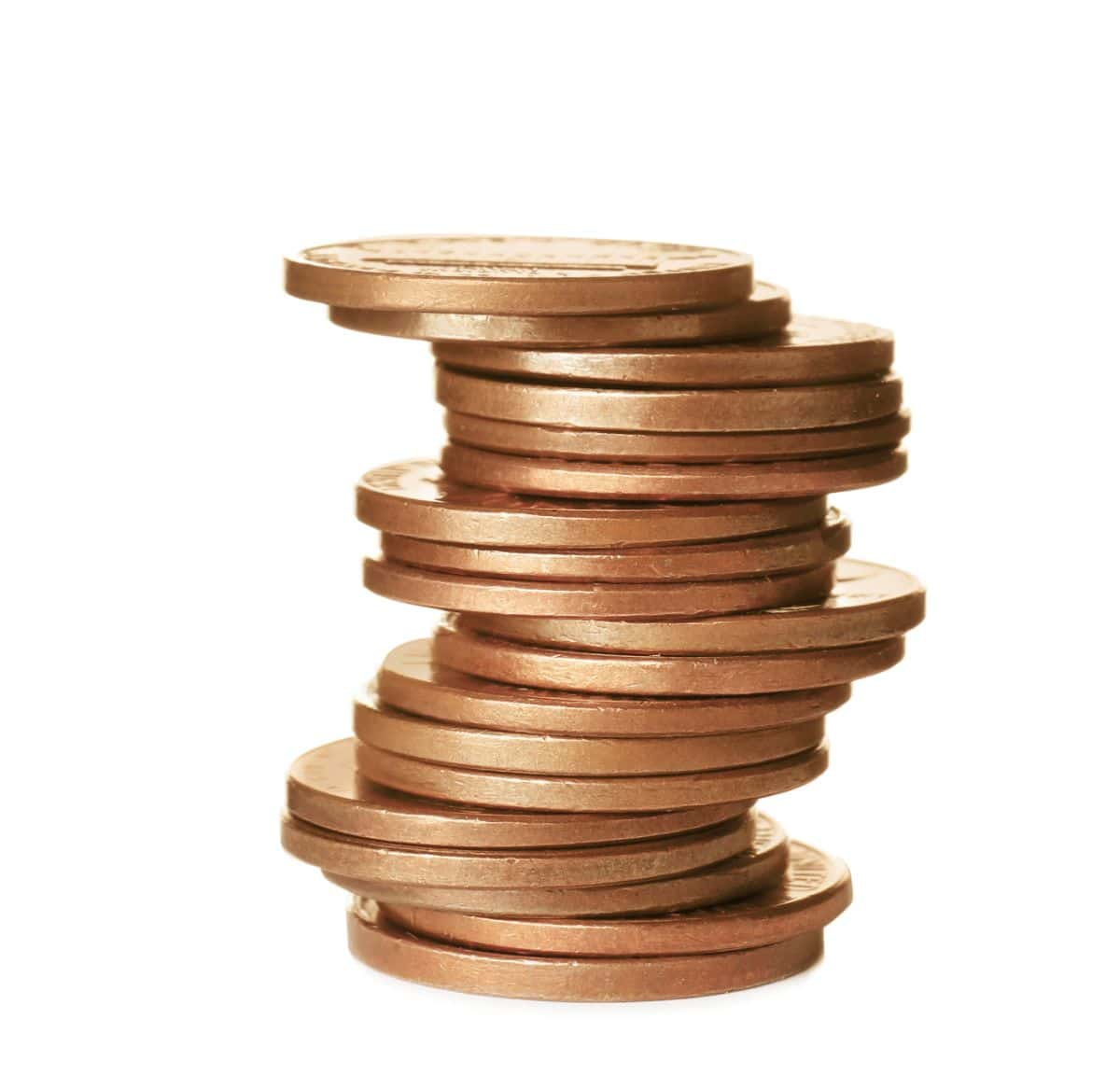 a stack of copper coins on a white background