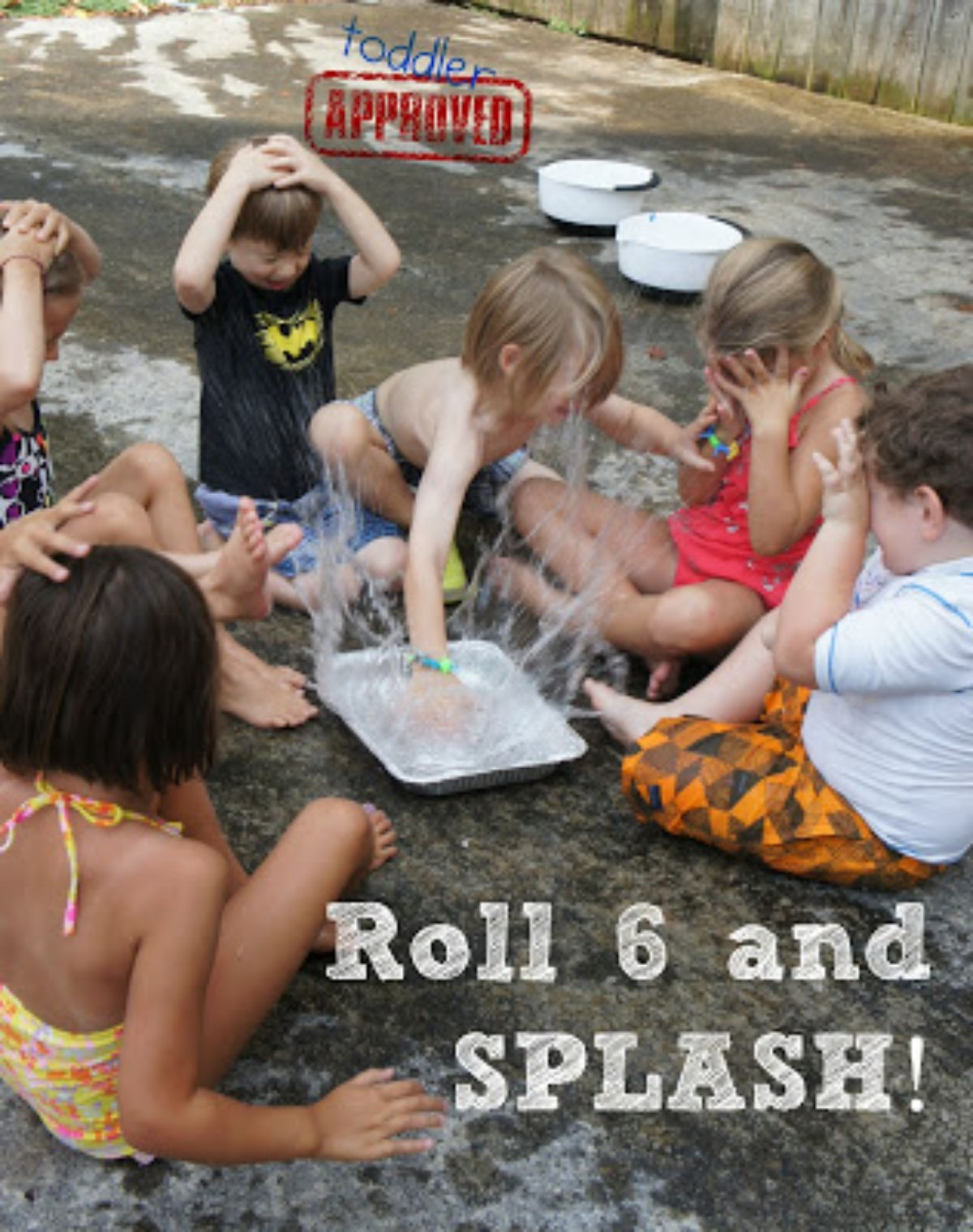 """The text reads """"Roll 6 and Splash! Toddler approved"""" 6 children sit in a circle with hands over their faces. One child is slapping water in a white tray"""