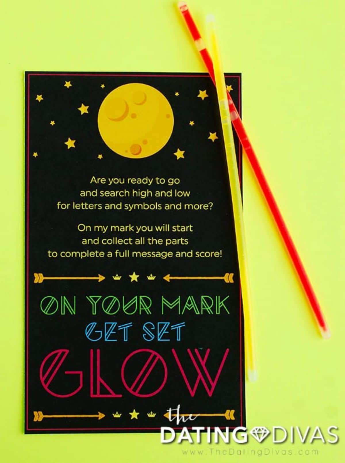 on a yellow background is a black piece of paper with a moon at the top. 2 glow sticks are on the right hand side