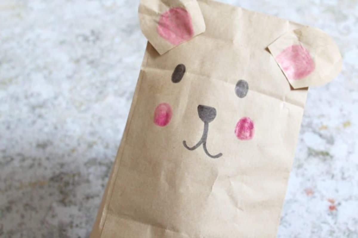 a paper bag has been decorated to look like a bear