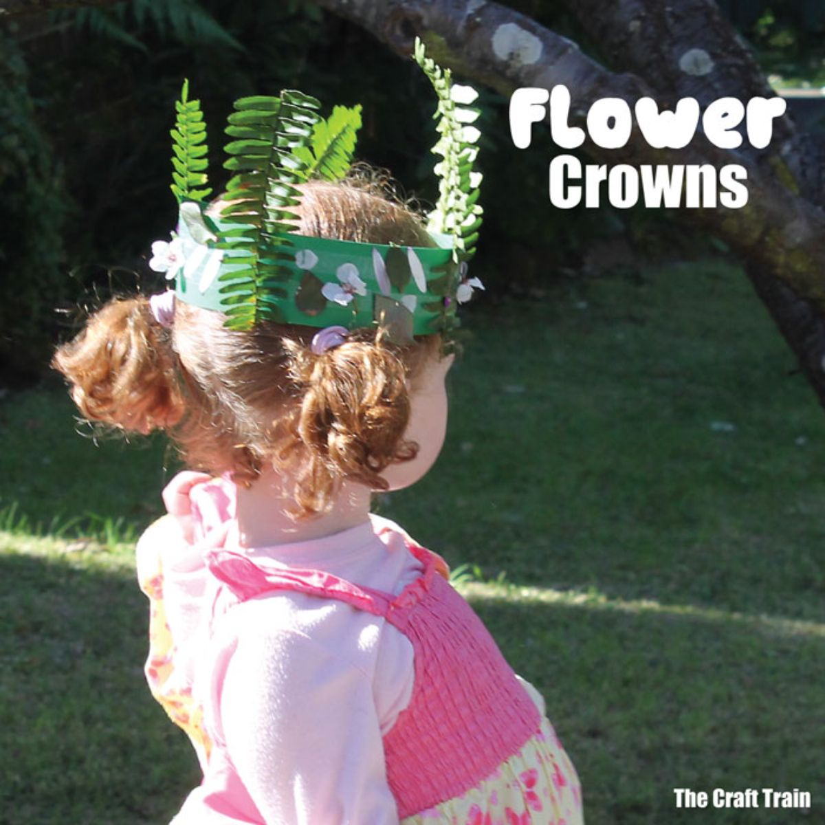 """the text reads """"flower crowns"""" the image is a back view of a girl in a pink dress wearing a crown made of sugar paper and leaves"""