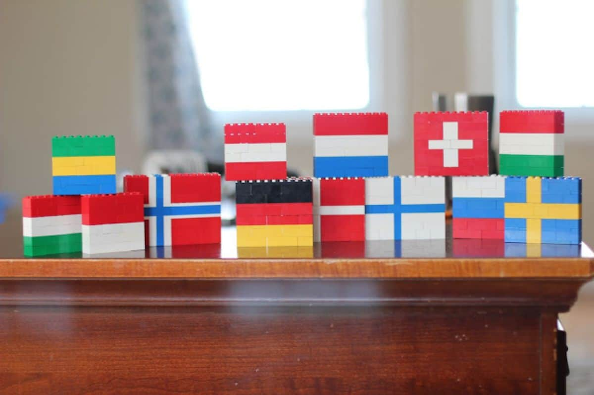 on a table top are several different flags made of lego