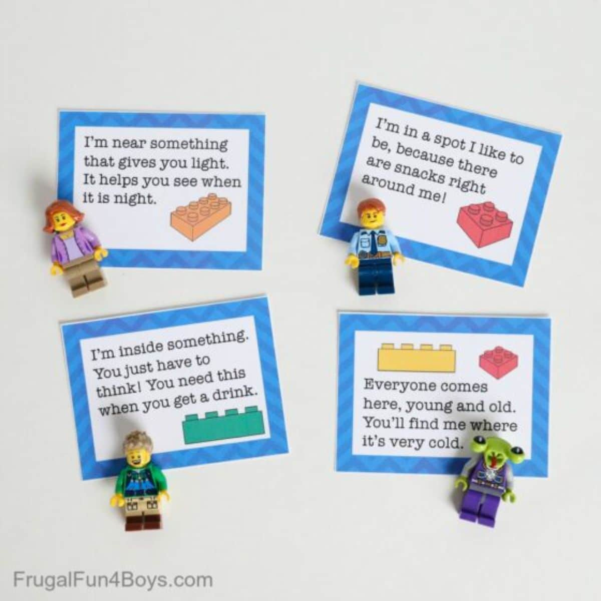4 bordered cards are laid out with clues on them and a lego figure in front of them