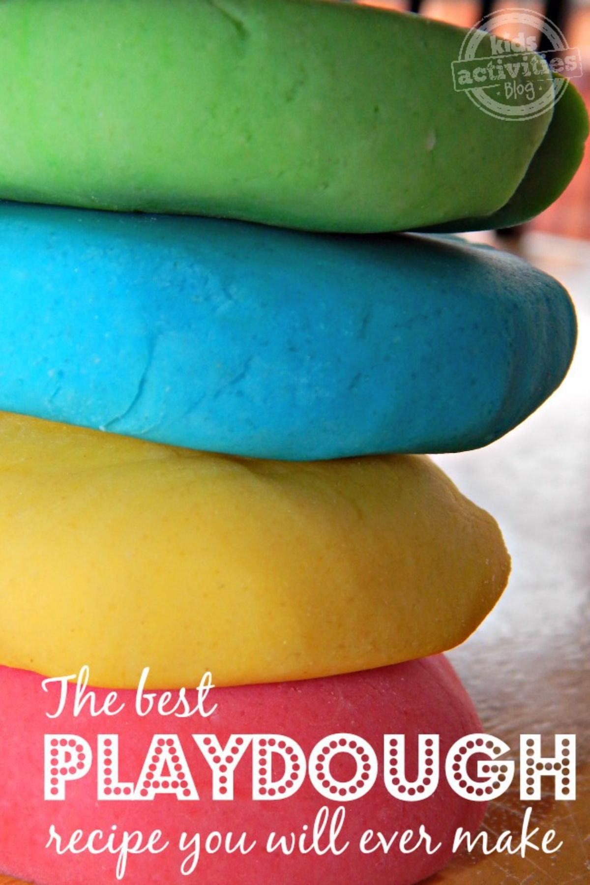 """the text reads """"The best playdough recipe you will ever make."""" The image is of a pile of red, yellow, blue and green blobs of playdough"""