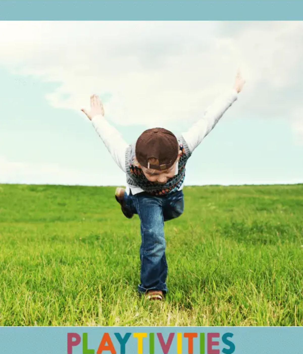A boy stands in a field bent over with his hands in the air.