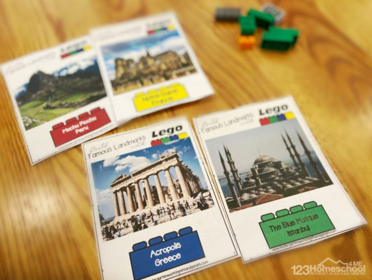 on a table are 4 cards with famous landmarks on them