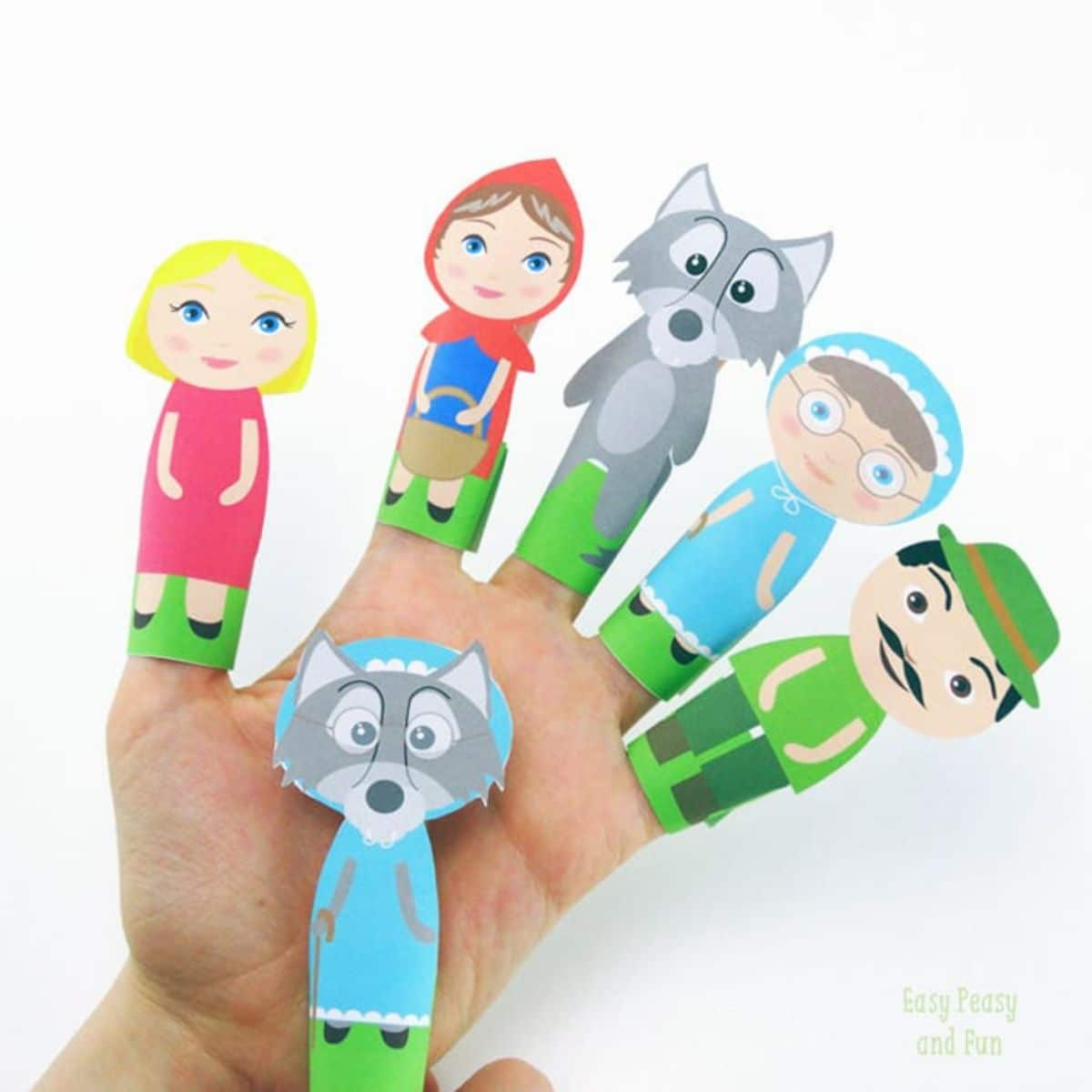 A hand has a finger puppet of a red riding hood character on each of the fingers