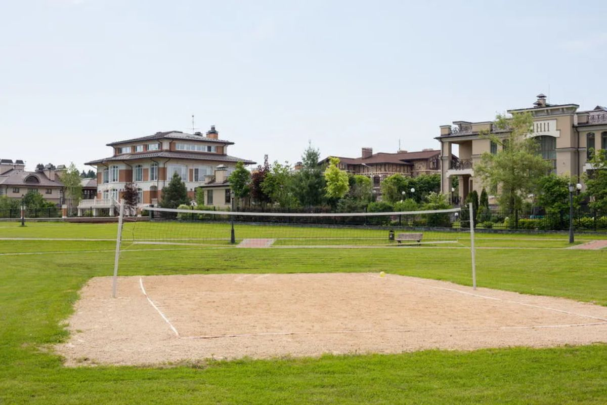 a volleyball court in front of some houses