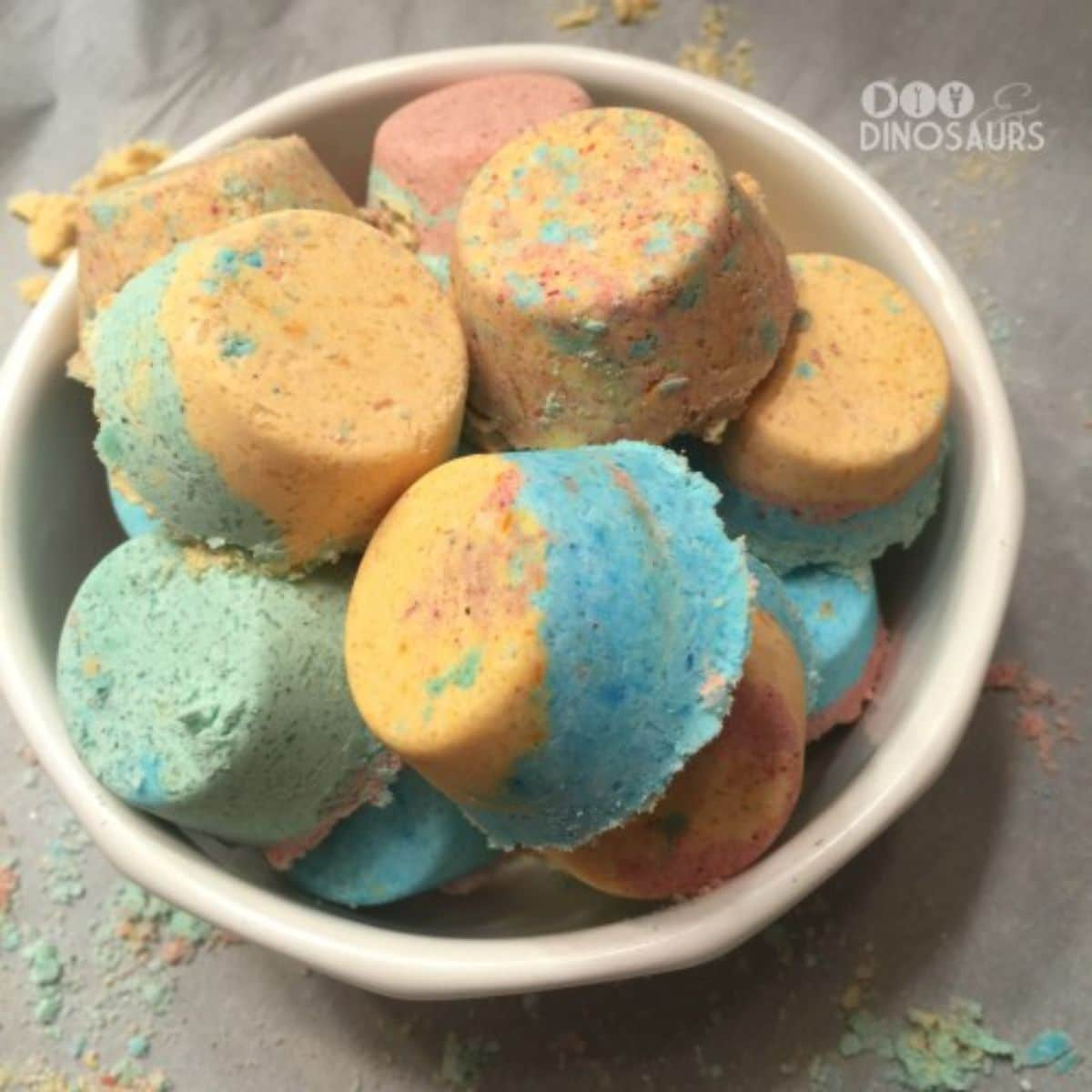 a bowl of multicolored bath bombs