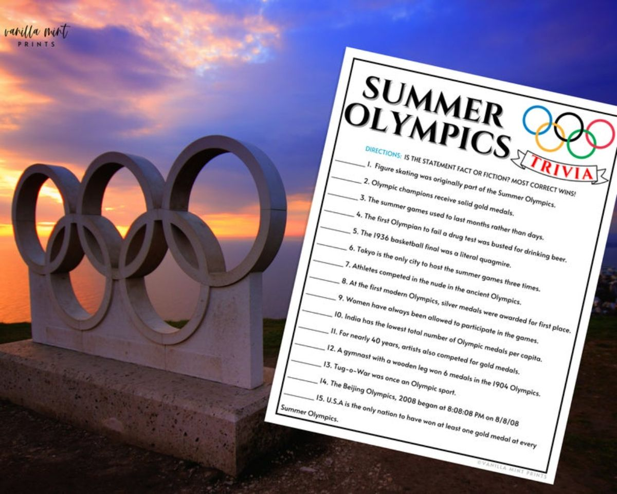 a photo of stone oympic rings, with a trivia sheet next to it