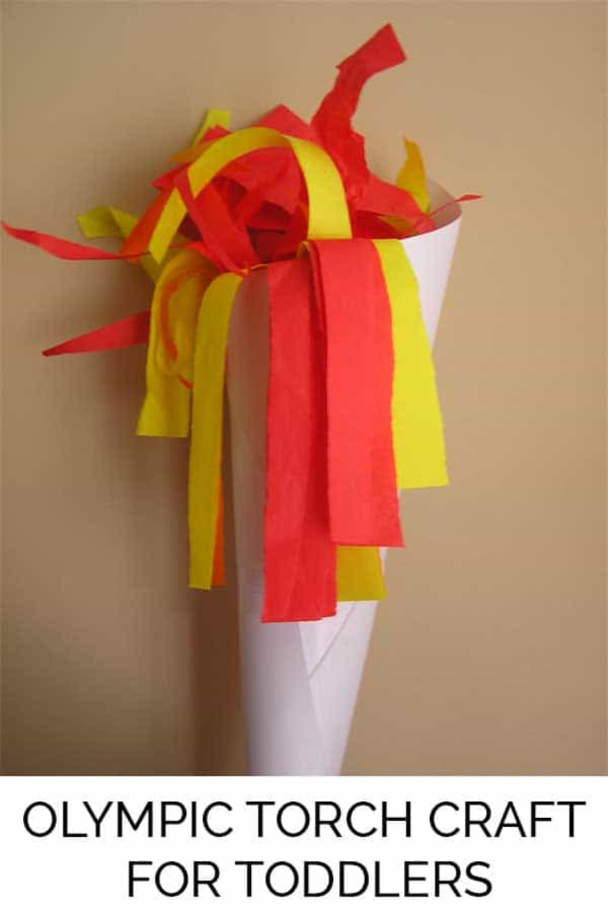 a torch made of a cone of white paper, with red and yellow tissue paper as the flames