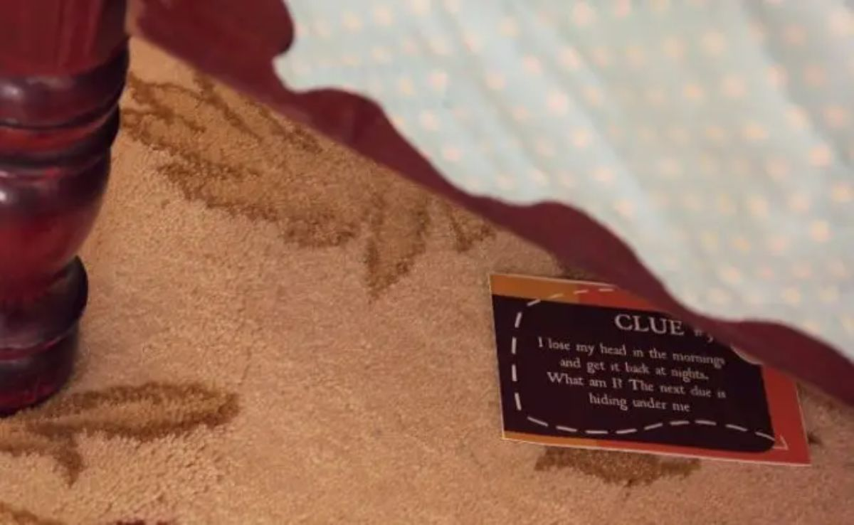 a card hides under a cloth with CLUE written on it