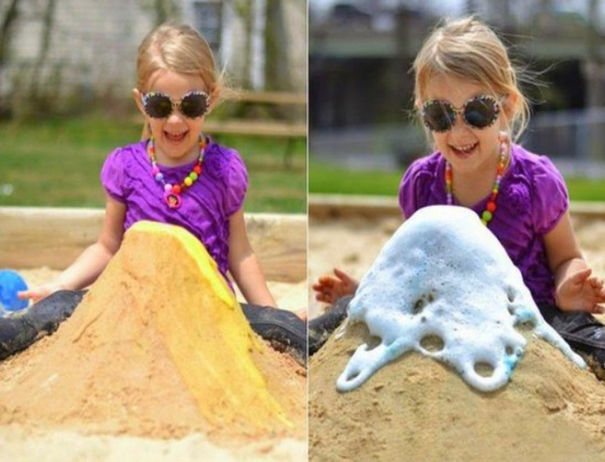 2 images of a girl in a purple top and sunglasses sits behind a sand volcano with liquid exploding out of the top