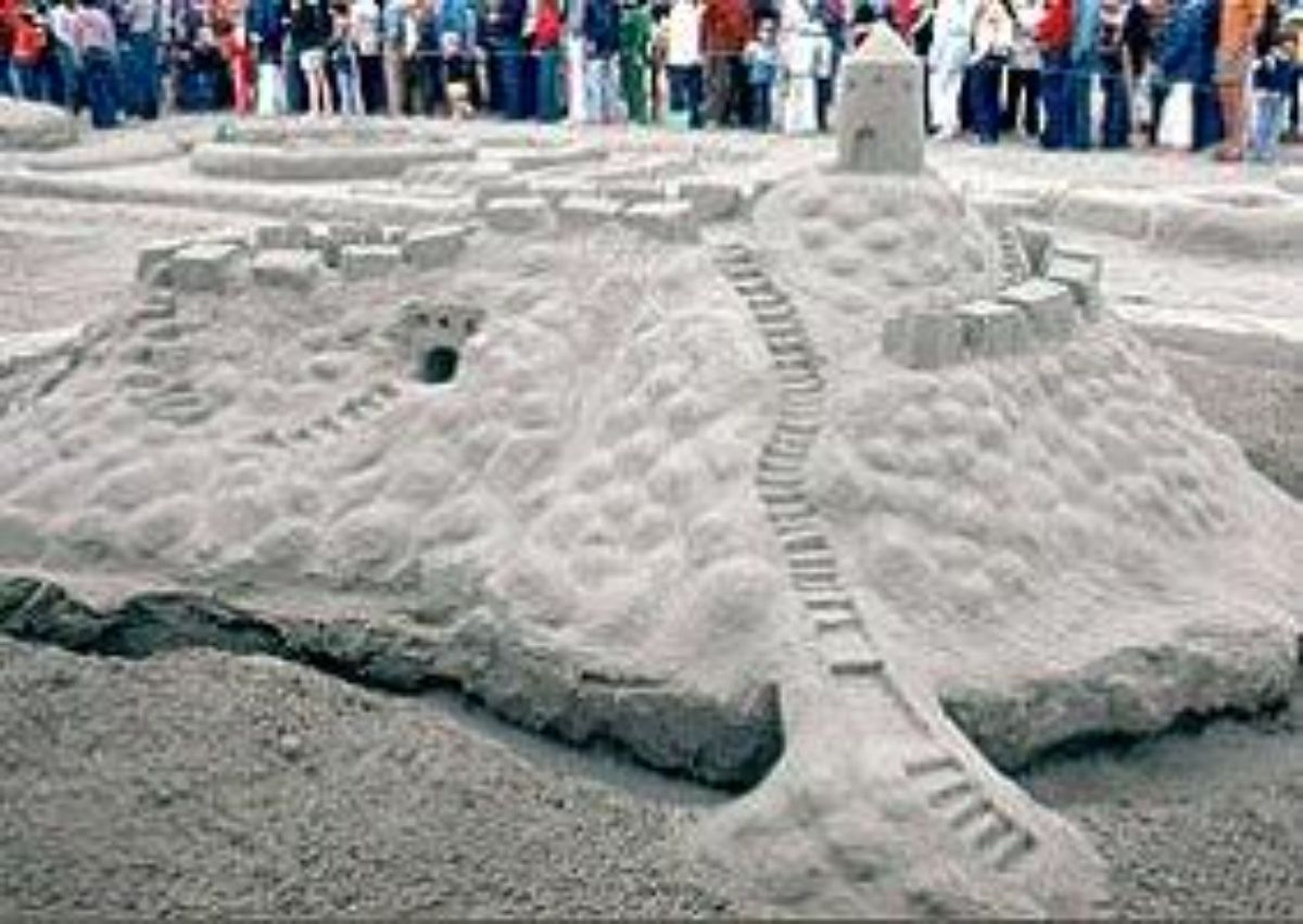 a detialed castle made out of sand